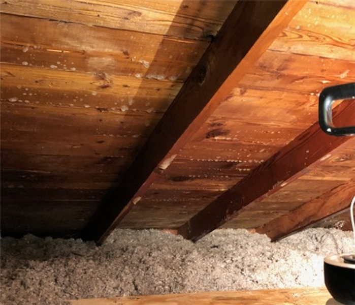an attic with clean wood planks