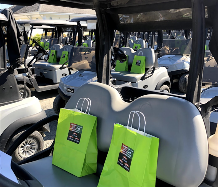 golf carts with green bags on them