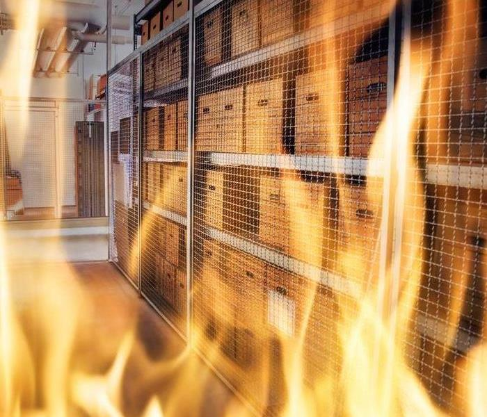Flames in an office with storage boxes stacked